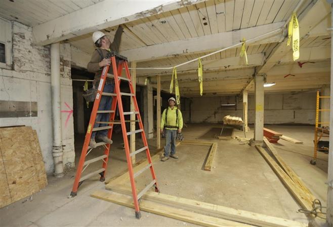 Zach Peterson (left) and Tim Navis, both of Northcentral Construction out of Fond du Lac, work on framing up a stairwell at what will be the Shoe Factory Lofts apartments in Walker's Point.